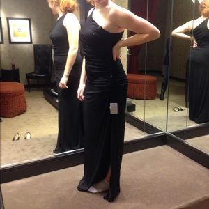 Black one shoulder gown with leg slit and beading